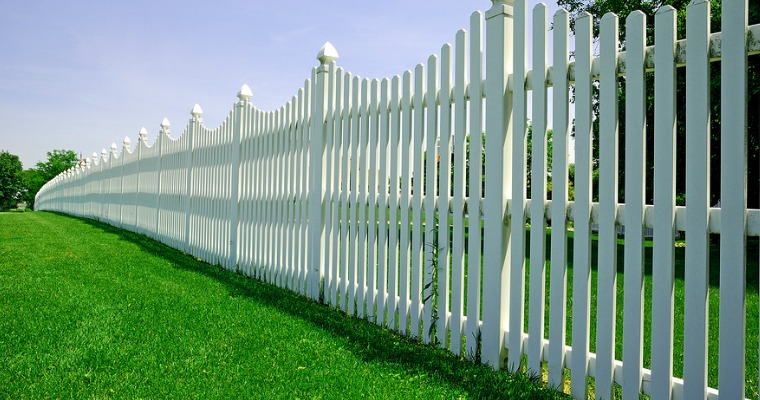 How to Prevent Grass From Growing Under Your Fence