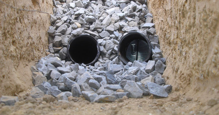 French Drain vs Trench Drain: Which Is Right for My Landscape?
